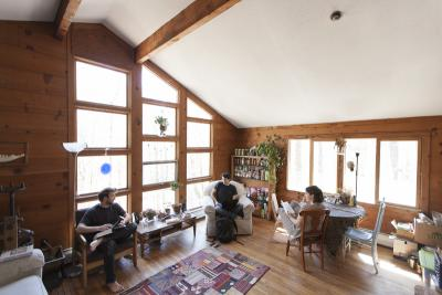 Students enjoy the sunny common room in the farm cottage.
