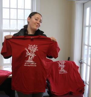 Krystal Graybeal models a T-shirt to commemorate the shredding of documents.